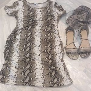 Snakeskin mini dress, sandals,and hat